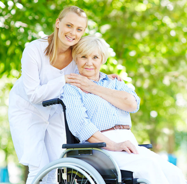 caregiver and old lady on wheelchair